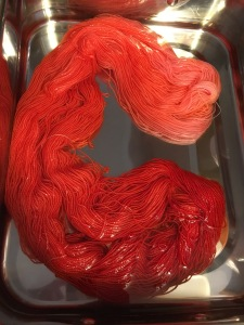 burnt orange and hot fuchsia dip-dyed yarn